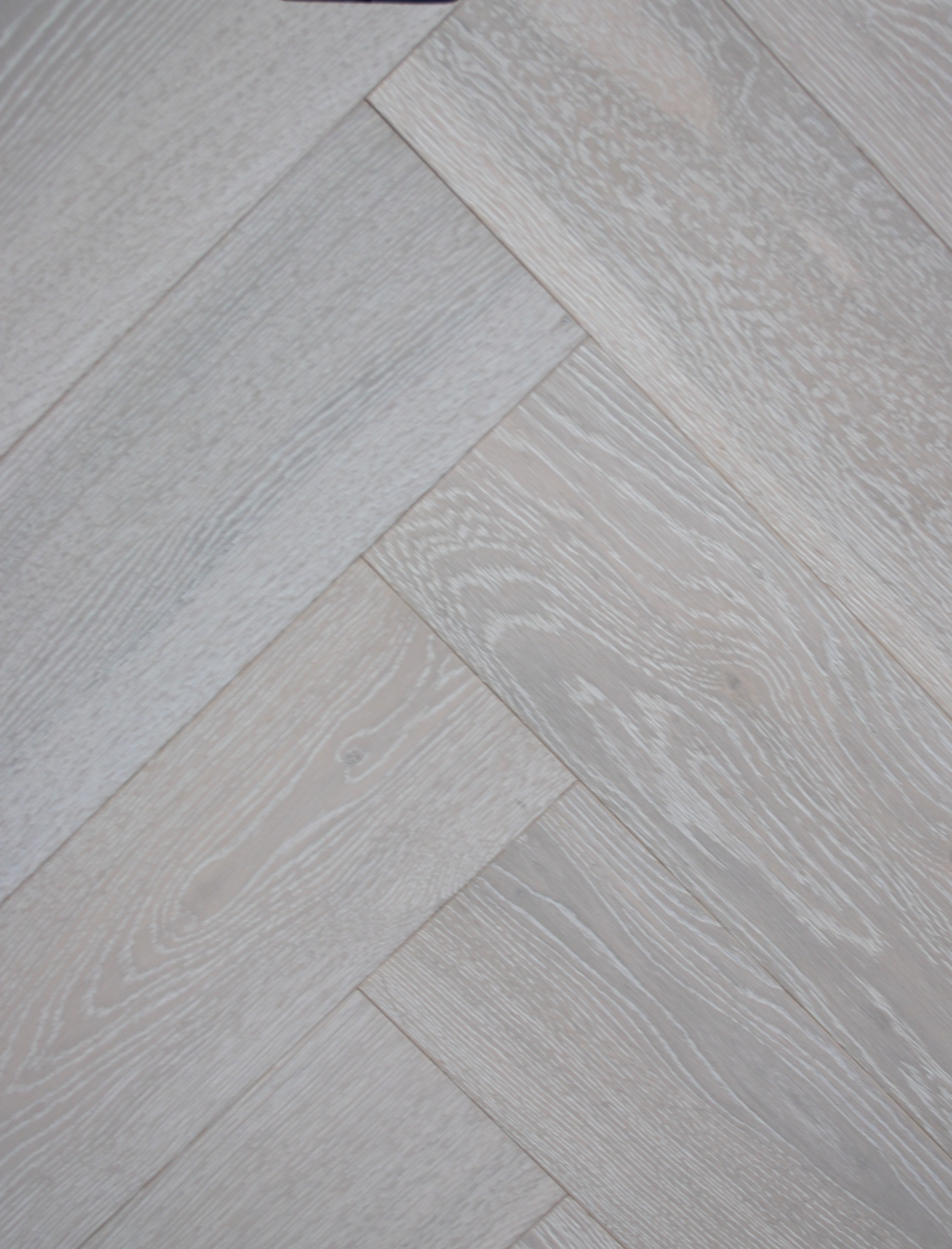 limed and white oiled engineered oak herringbone wood