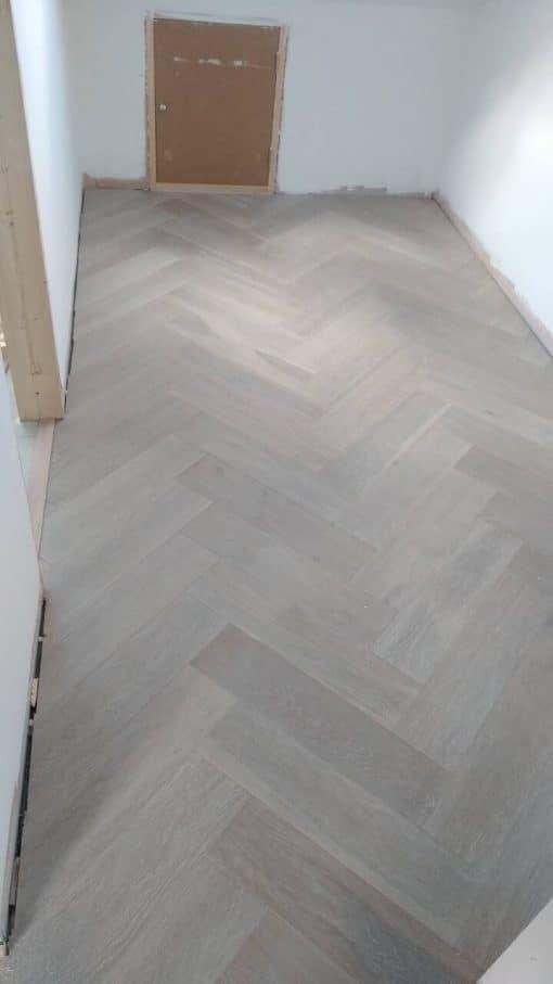 Limed and white oiled Engineered oak herringbone wood blocks